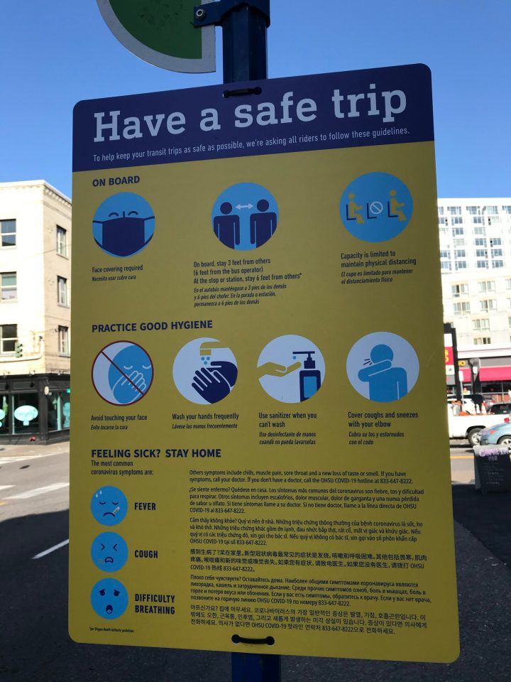 Photo of COVID-19 health & safety tips from TriMet at a bus stop.
