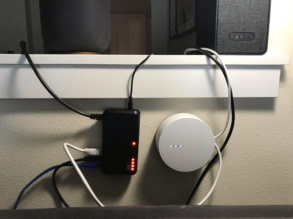 Photo of a wall-mounted network switch and ZigBee hub.