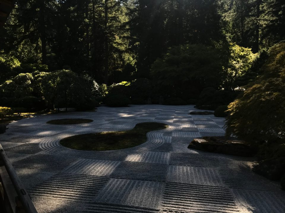 Photo of a sand garden at Portland Japanese Garden raked in a pattern for the Moon Viewing Festival.