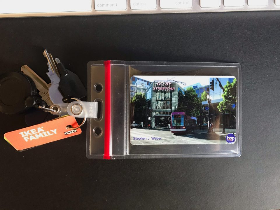 Photo of a custom Hop card in a badge holder on a keyring.