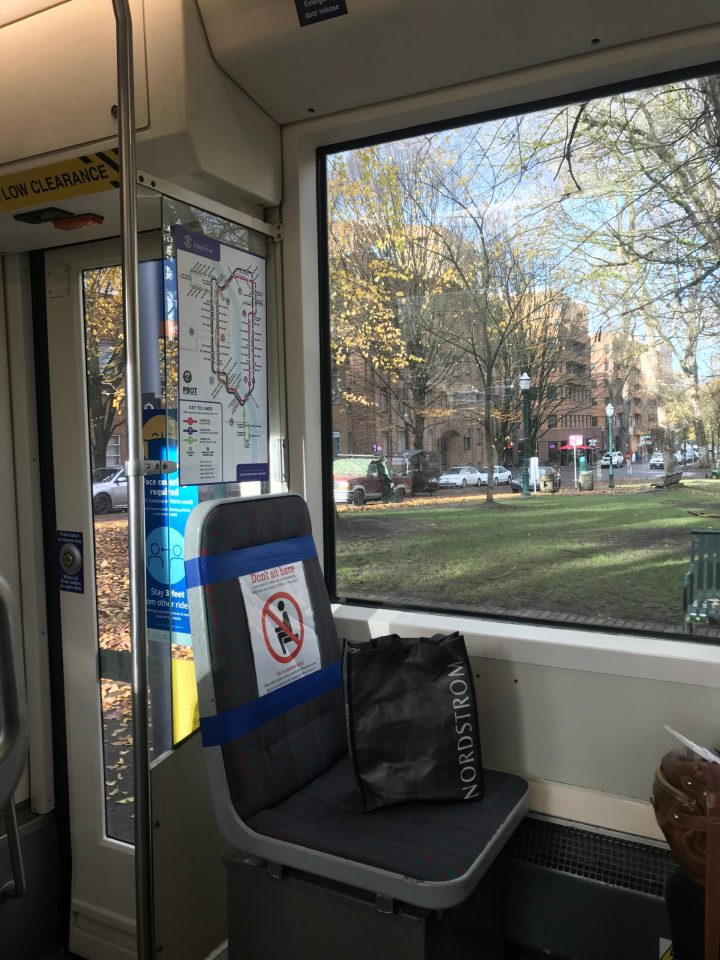 Photo of UPS transporting deliveries by bike on the Park Blocks as seen from a Portland Streetcar train.