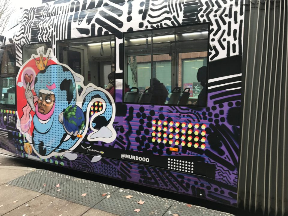 Photo of artwork by a local African American artist on the side of Portland Streetcar 025.