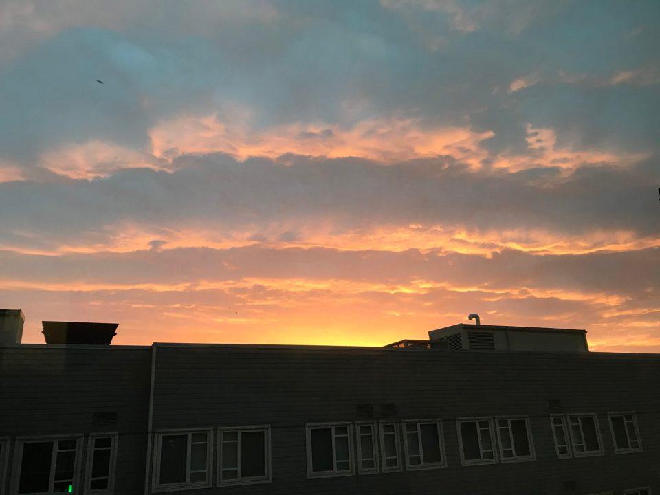 Photo of a cloudy sunrise in Portland.