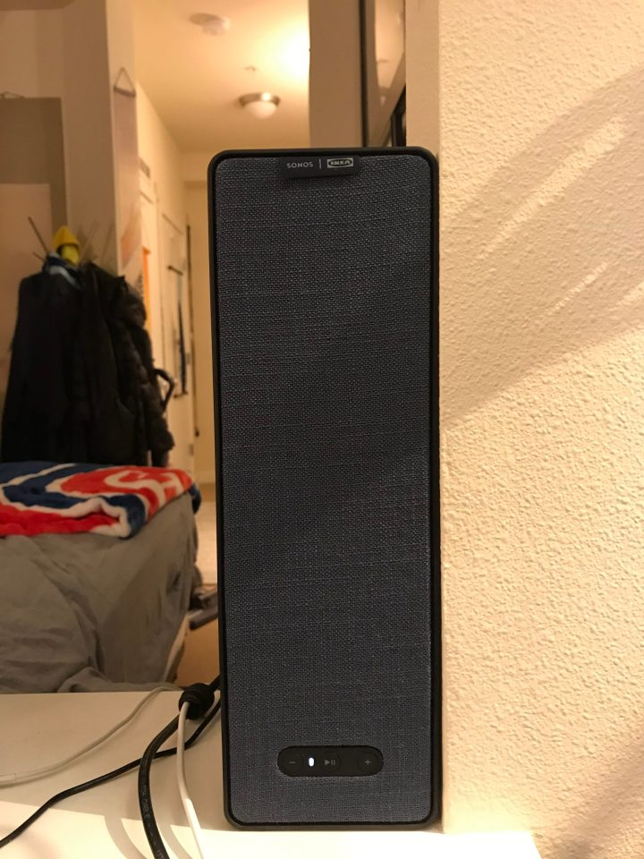 Photo of a blue speaker griddle on an IKEa + Sonos Symfonisk bookshelf speaker.