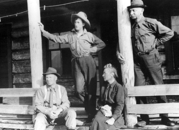 R.H. Campbell, Walter Potts, Mrs. Fernow, and Dr. Fernow on Bow River Forest, Alberta, 1915.