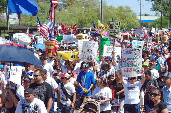 Tens of thousands marched for immigration reform in Phoenix, AZ on Saturday - Photo: A family at Saturday's protest in Phoenix - Photo: José Muñoz