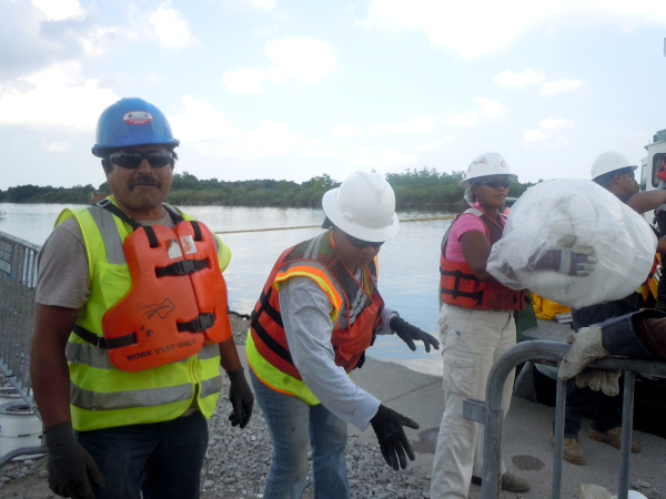 Cleanup workers in Hopedale, LA - Photo: Annie Correal