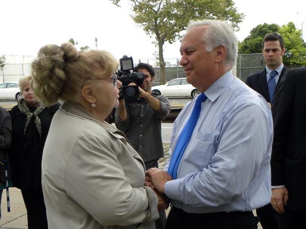 Assemblyman Richard Brodsky speaks with Nelly Braginsky who lost her son Alex on September 11th - Photo: Ewa Kern-Jedrykowska