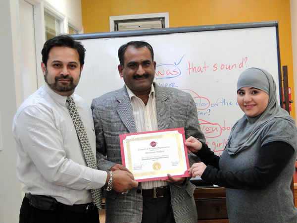 Mustansar Waheed proudly holds his certificate for passing a U.S. citizenship course - Photo: Mohsin Zaheer