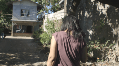 Film still from Documented - Emily Salinas walking to her house. (Photo: APO Productions)