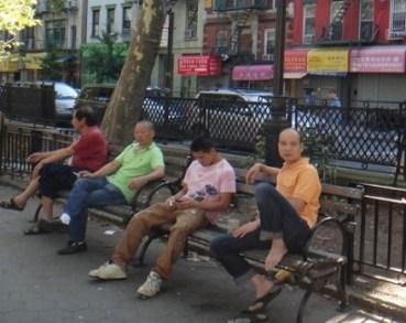 Men smoking in a Chinatown park.