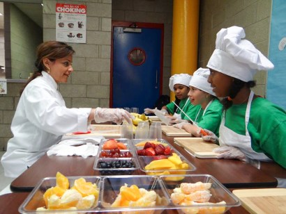 Tania Lopez with Coqui the Chef students