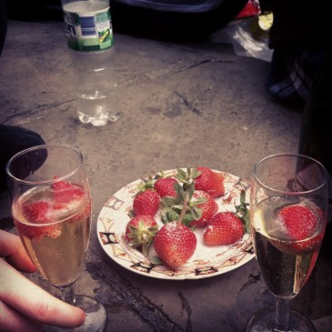 bubbles and strawberries... sitting on the pavement... so classy!