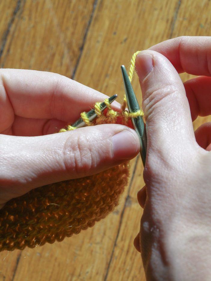 Bring yarn to back.