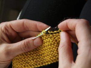 Step 5: Two stitches forward, one stitch back, drop the first stitch.