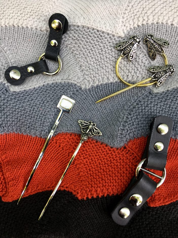 image of shawl sticks and leather knit closures.