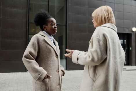 women talking outside