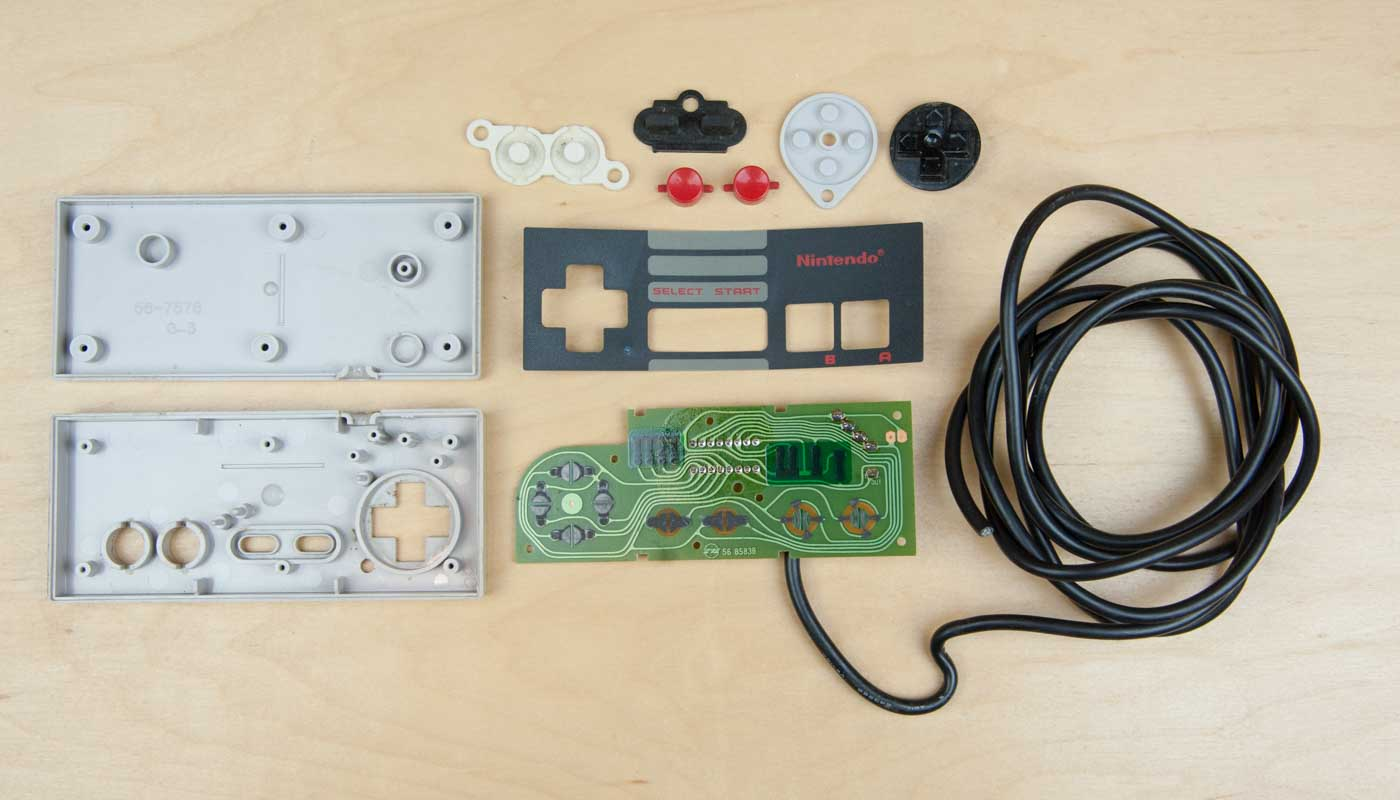 hight resolution of first up the very first nintendo entertainment system nes controller in all its boxy glory it s pretty simple 8 buttons 1 shift register