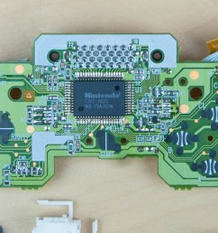 the pcb we see a lot more complexity compared with the previous controllers this one has a lot more processing power to support a custom nintendo chip  [ 1190 x 680 Pixel ]