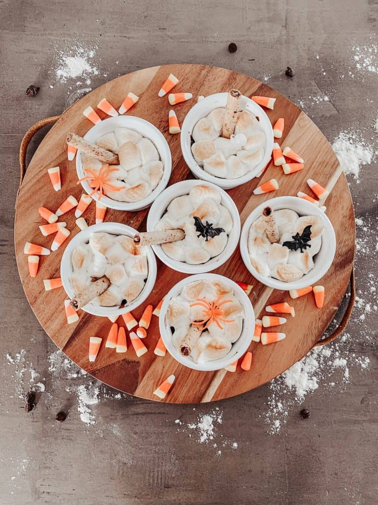 ramekin s'mores lava cakes decorated for halloween with candy corn and plastic halloween rings