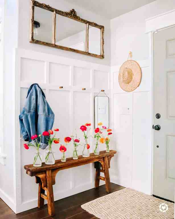 farmhouse entryway with white board and batten and wood bench