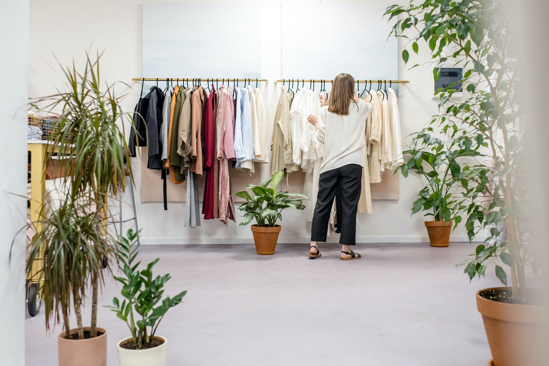 woman fixing clothes on the rack