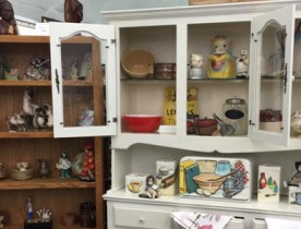 A cabinet filled with household items.