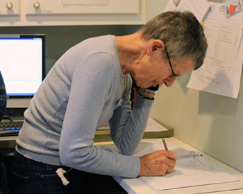 A volunteer answering a phone call.
