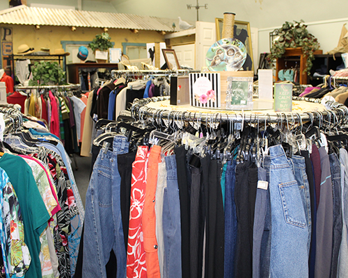 Racks of clothing at FieldHaven Marketplace.