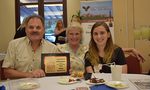 Nicole Gauthier, Benay Clark, and George Barreto accepting the 2017 Best of the Best Thrift Store Award