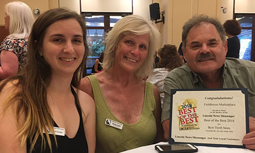 Nicole Gauthier, Benay Clark, and George Barreto accepting the 2018 Best of the Best Thrift Store Award