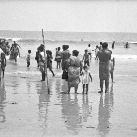 Crowds bathe in the Bay of Bengal on the shore of Sagar Island where the Ganges River enters the sea