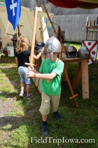 My boy tries on a helment at Medieval & Renaissance Society at the Renaissance Faire at Sleepy Hollow