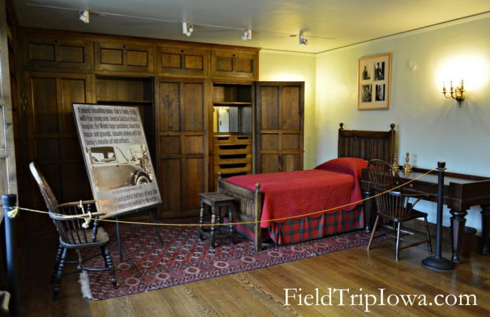 Salisbury House & Gardens Hud's bedroom with a few peices of furniture and informational display board