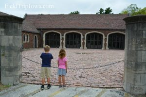Salisbury House & Gardens Children look into the driveway and garage area