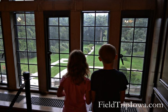 Salisbury House & Gardens children look out window into garden