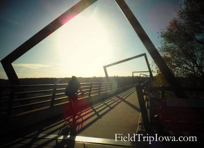 biker at sunset on High Trestle Trail Bridge