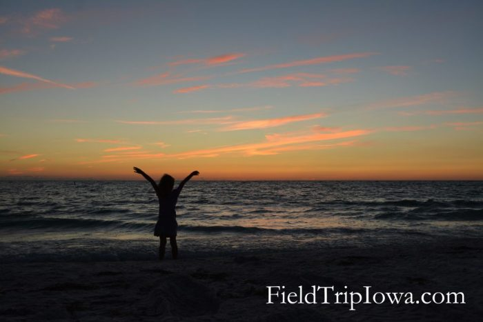 Silhouette of a girl at sunset on Anna Maria Island Florida.