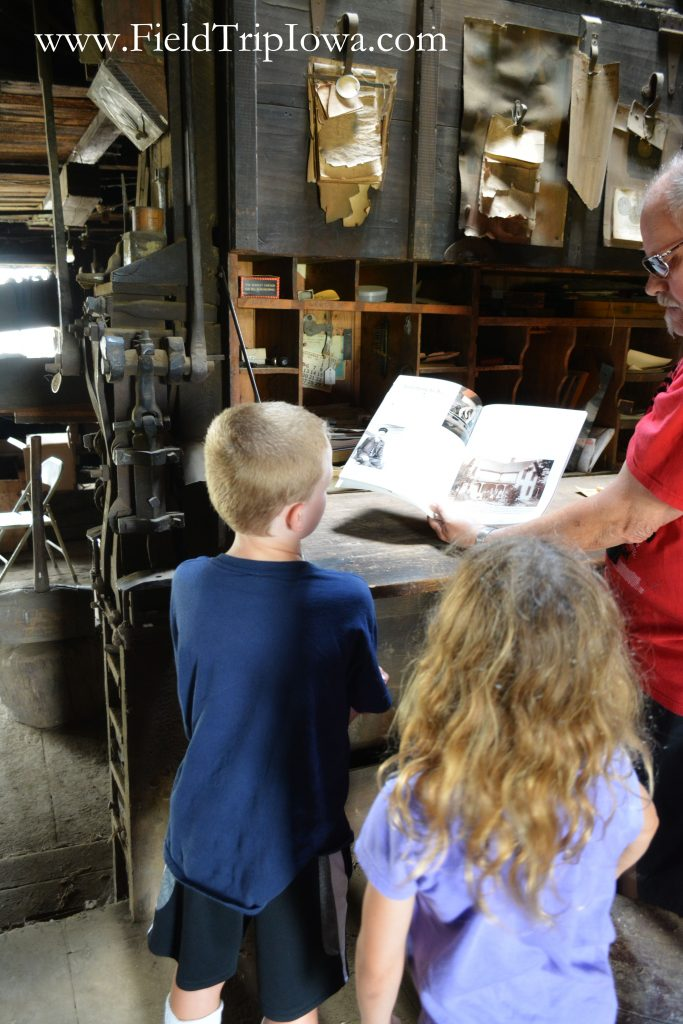 Children learning at Matt Edel Blacksmith Shop in Iowa