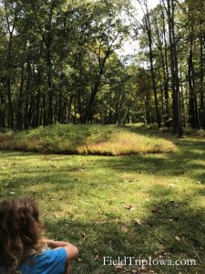 Girl looking at Compount Mound at Effigy Mounds National Monument Iowa