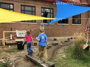Kids walk across bridge at natural playspace Minnesota State Fair