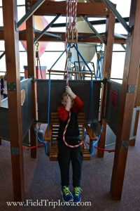 Child uses pully swing at Bluedorn Science Imaginarium in Waterloo Iowa.