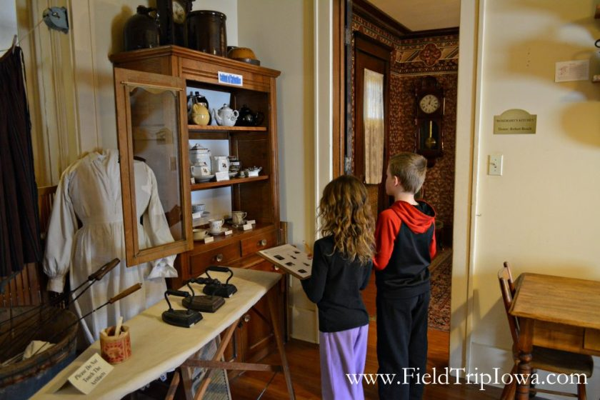 Children exploring the victorian home at Cedar Falls Historical Society in Iowa