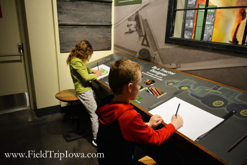Children draw at John Deere Tractor And Engine Museum in Waterloo Iowa.