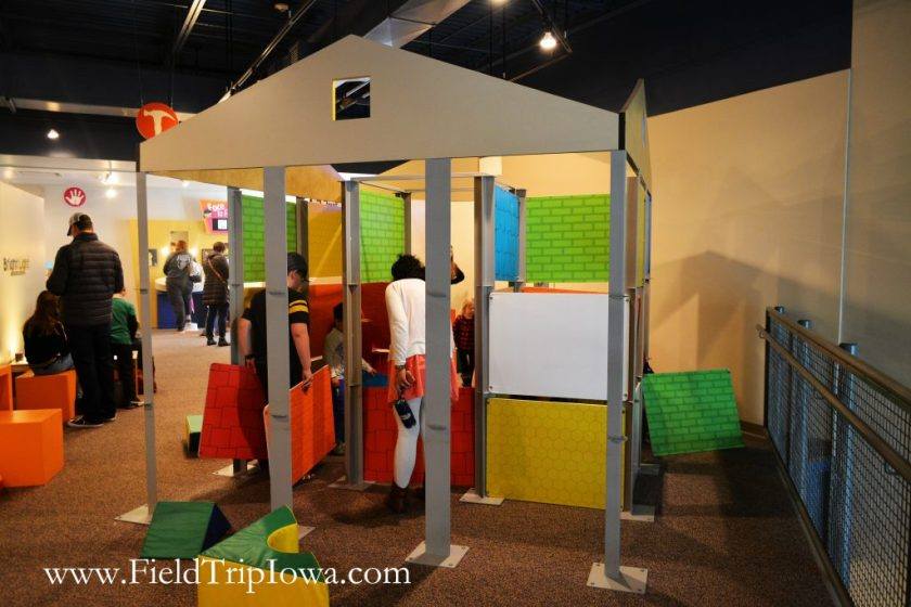 Children build a house at Phelps Youth Pavilion in Waterloo Iowa
