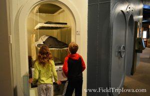 Children look at Sullivan Brothers Iowa Veterans Museum Waterloo navy display