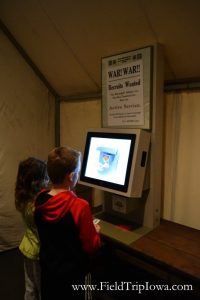 Children scan dogtags at Sullivan Brothers Iowa Veterans Museum Waterloo