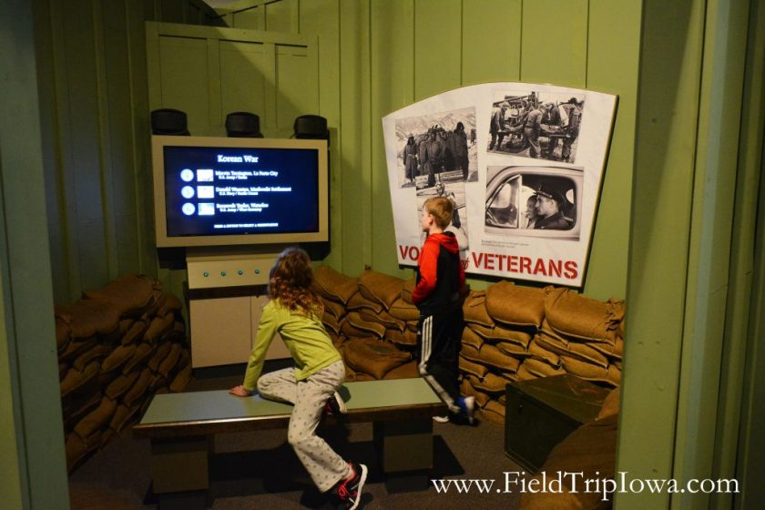 Children inside a viewing room at Sullivan Brothers Iowa Veterans Museum Waterloo