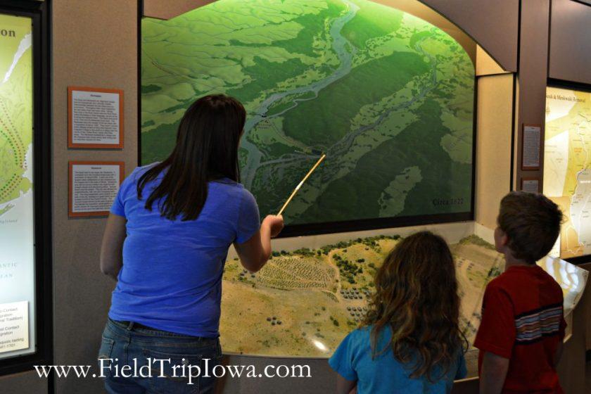 Guide explains map to children at John Hauberg Indian Museum