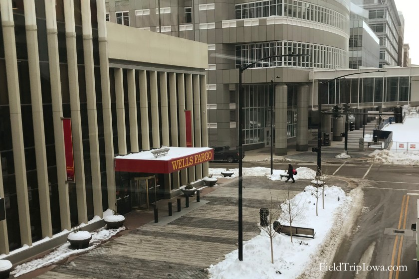 Snowy day lookig out of skywalk to the entrance of Wells Fargo History Museum Des Moines Iowa.